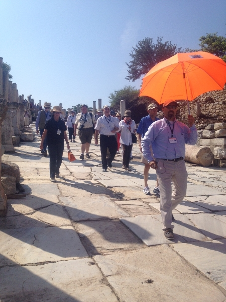 Carrying orange umbrellas made it so easy for the guests to follow their guides at Ephesus